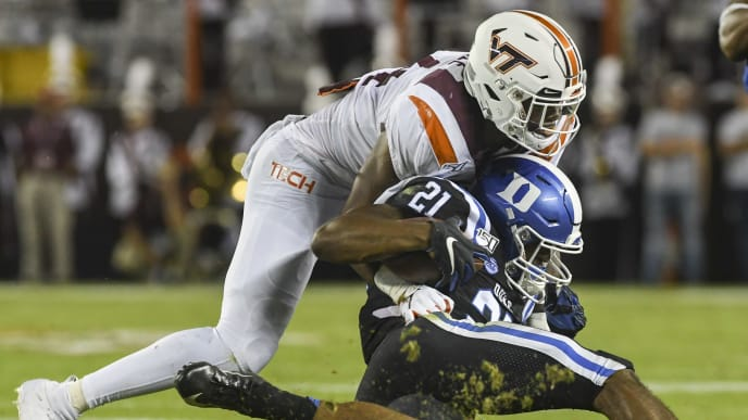 BLACKSBURG, VA - SEPTEMBER 27: Running back Mataeo Durant #21 of the Duke Blue Devils is hit by linebacker Alan Tisdale #34 of the Virginia Tech Hokies in the first half at Lane Stadium on September 27, 2019 in Blacksburg, Virginia. (Photo by Michael Shroyer/Getty Images)