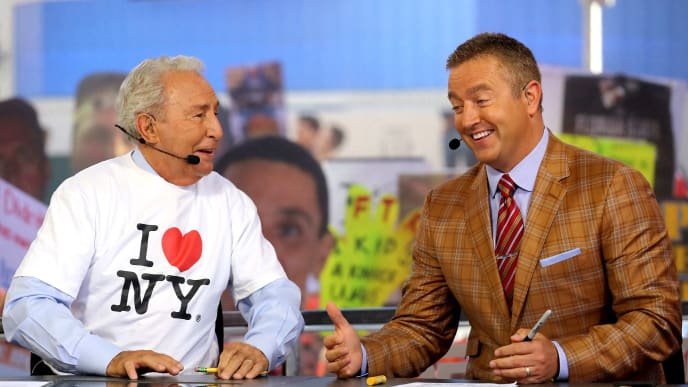 NEW YORK, NY - SEPTEMBER 23:  ESPN College Gameday Analysts Lee Corso (L) and Kirk Herbstreit discuss College Gameday at Times Square on September 23, 2017 in New York City.  (Photo by Abbie Parr/Getty Images)