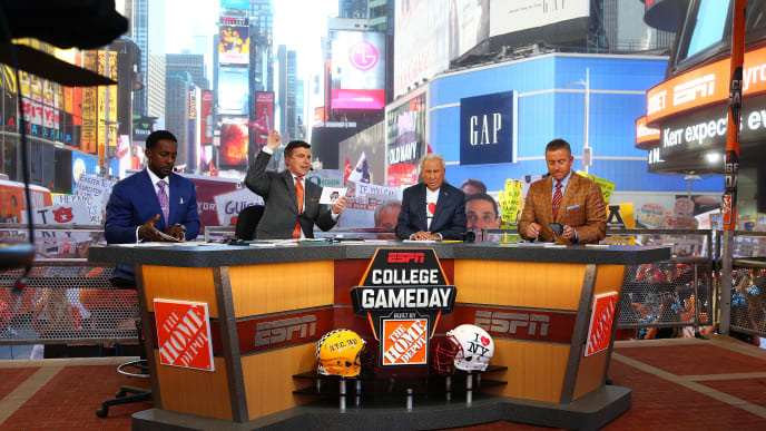 NEW YORK, NY - SEPTEMBER 23:  Lee Corso, Kirk Herbstreit, Chris Fowler are seen during ESPN's College GameDay show at Times Square on September 23, 2017 in New York City.  (Photo by Mike Stobe/Getty Images)