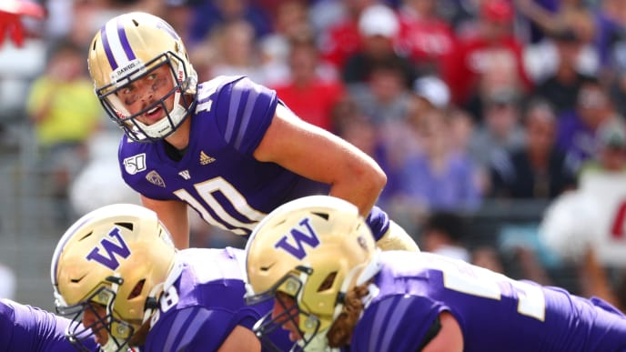 SEATTLE, WASHINGTON - AUGUST 31: Jacob Eason #10 of the Washington Huskies looks down the field in the fourth quarter against the Eastern Washington Eagles during their game at Husky Stadium on August 31, 2019 in Seattle, Washington. (Photo by Abbie Parr/Getty Images)