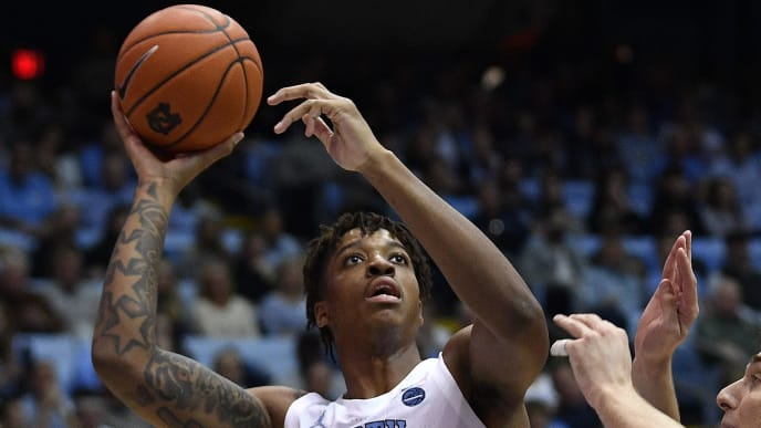 CHAPEL HILL, NORTH CAROLINA - NOVEMBER 20: Armando Bacot #5 of the North Carolina Tar Heels shoots over Federico Poser #5 of the Elon Phoenix during the second half of their game at the Dean Smith Center on November 20, 2019 in Chapel Hill, North Carolina. North Carolina won 75-61. (Photo by Grant Halverson/Getty Images)