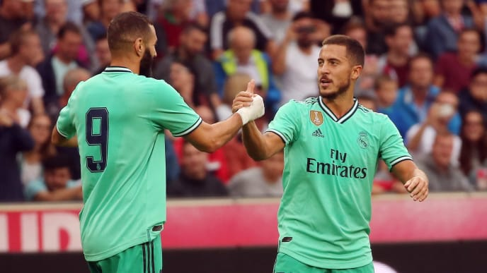 Real Madrid's forward Eden Hazard celebrates scoring with his team-mate Real Madrid's French forward Karim Benzema (L) during the pre-Season friendly football match FC Red Bull Salzburg v Real Madrid in Salzburg, Austria on August 7, 2019. (Photo by KRUGFOTO / APA / AFP) / Austria OUT        (Photo credit should read KRUGFOTO/AFP/Getty Images)