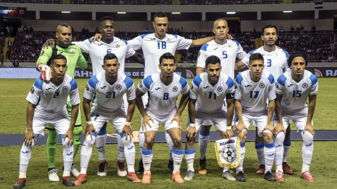 Nicaragua's national football team players pose for pictures before their CONCACAF Gold Cup 2019 football match against Costa Rica, at the National Stadium in San Jose, Costa Rica, on June 16, 2019. (Photo by Ezequiel BECERRA / AFP)        (Photo credit should read EZEQUIEL BECERRA/AFP/Getty Images)