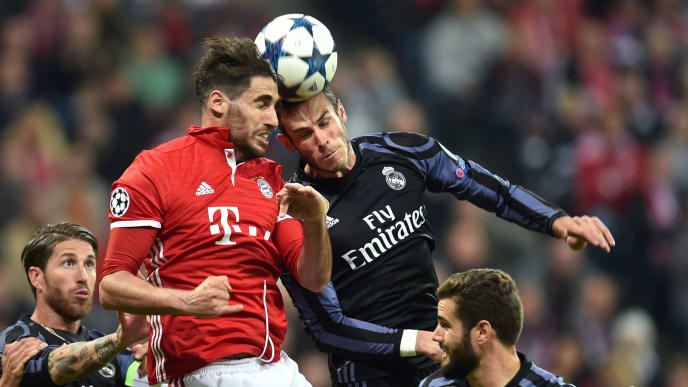 (L-R) Real Madrid's defender Sergio Ramos, Bayern Munich's Spanish midfielder Javi Martinez, eal Madrid's Welsh forward Gareth Bale and Real Madrid's defender Nacho Fernandez  vie for the ball during the UEFA Champions League 1st leg quarter-final football match FC Bayern Munich v Real Madrid in Munich, southen Germany on April 12, 2017.  Security was ratcheted up in Munich, one day after three explosions rocked the team bus of German football club Borussia Dortmund minutes after the bus set off to a planned Champions League game against Monaco on Tuesday night (April 11, 2017). / AFP PHOTO / Christof STACHE        (Photo credit should read CHRISTOF STACHE/AFP/Getty Images)