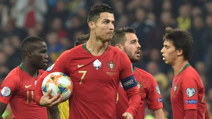 Portugal's forward Cristiano Ronaldo holds the ball during the Euro 2020 football qualification match between Ukraine and Portugal at the NSK Olimpiyskyi stadium in Kiev on October 14, 2019. (Photo by Genya SAVILOV / AFP) (Photo by GENYA SAVILOV/AFP via Getty Images)