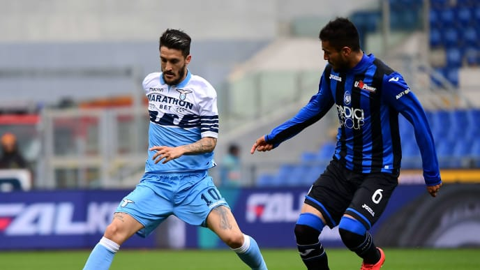 Lazio's forward from Spain Luis Alberto (L) in action with Atalanta's defender from Argentine Jose Luis Palomino during the Italian Serie A football match Lazio vs Atalanta on May 5, 2019 at the Olympic stadium in Rome. (Photo by Vincenzo PINTO / AFP)        (Photo credit should read VINCENZO PINTO/AFP/Getty Images)