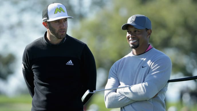 SAN DIEGO, CA - JANUARY 27: Dustin Johnson and Tiger Woods wait to putt on the 12th green during the second round of the Farmers Insurance Open at Torrey Pines North on January 27, 2017 in San Diego, California.  (Photo by Jeff Gross/Getty Images)