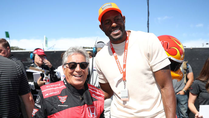 MONTEREY, CALIFORNIA - SEPTEMBER 22: Andre Iguodala and Mario Andretti pose for a photo during the NTT IndyCar Firestone Grand Prix of Monterey at WeatherTech Raceway Laguna Seca on September 22, 2019 in Monterey, California. (Photo by Chris Graythen/Getty Images)