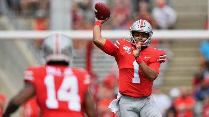 COLUMBUS, OH - AUGUST 31:  Quarterback Justin Fields #1 of the Ohio State Buckeyes completes a pass to K.J. Hill #14 of the Ohio State Buckeyes for a first down in the third quarter against the Florida Atlantic Owls at Ohio Stadium on August 31, 2019 in Columbus, Ohio. Ohio State defeated Florida Atlantic 45-21.  (Photo by Jamie Sabau/Getty Images)