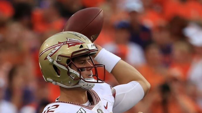 CLEMSON, SOUTH CAROLINA - OCTOBER 12: Alex Hornibrook #12 of the Florida State Seminoles drops back to pass against the Clemson Tigers during their game at Memorial Stadium on October 12, 2019 in Clemson, South Carolina. (Photo by Streeter Lecka/Getty Images)
