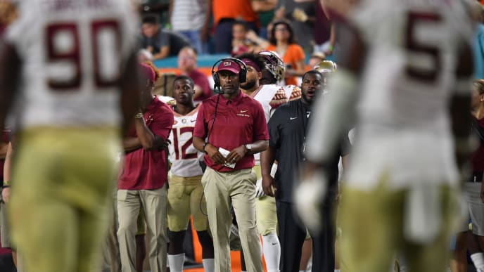 MIAMI, FL - OCTOBER 06: Head coach Willie Taggart of the Florida State Seminoles coaching in the second half against the Miami Hurricanes at Hard Rock Stadium on October 6, 2018 in Miami, Florida. (Photo by Mark Brown/Getty Images)