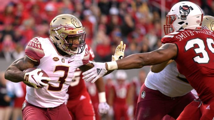 RALEIGH, NC - NOVEMBER 03: Cam Akers #3 of the Florida State Seminoles runs with the ball against James Smith-Williams #39 of the North Carolina State Wolfpack at Carter-Finley Stadium on November 3, 2018 in Raleigh, North Carolina. (Photo by Lance King/Getty Images)