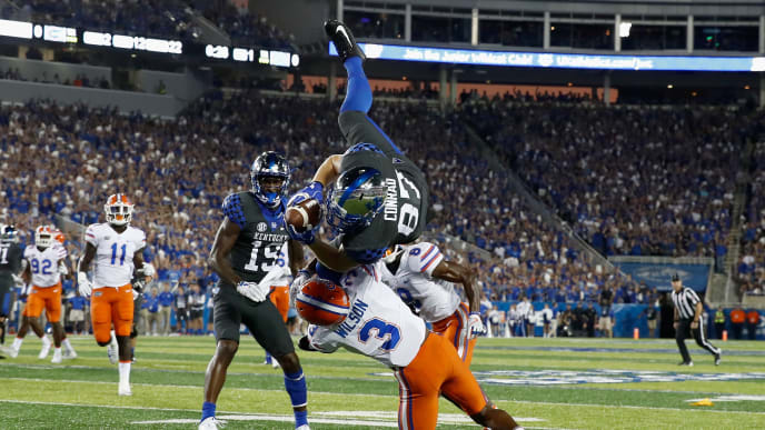 LEXINGTON, KY - SEPTEMBER 23: C.J. Conrad #87 of the Kentucky Wildcats leaps over Marco Wilson #3 of the Florida Gators during the game at Kroger Field on September 23, 2017 in Lexington, Kentucky.  (Photo by Andy Lyons/Getty Images)