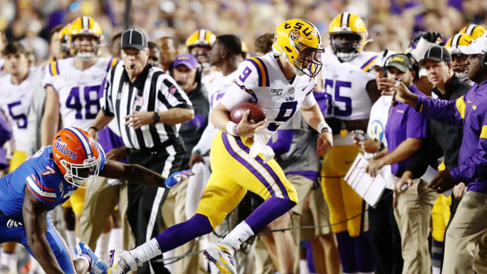 BATON ROUGE, LOUISIANA - OCTOBER 12: Quarterback Joe Burrow #9 of the LSU Tigers runs the ball against the Florida Gators at Tiger Stadium on October 12, 2019 in Baton Rouge, Louisiana. (Photo by Marianna Massey/Getty Images)
