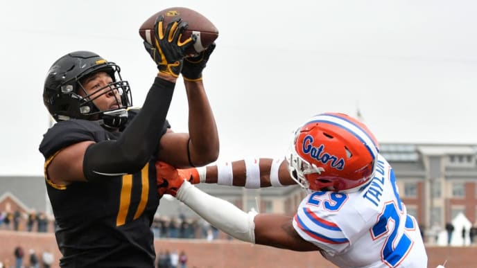 COLUMBIA, MO - NOVEMBER 4: Kendall Blanton #11 of the Missouri Tigers catches a touchdown pass against Jeawon Taylor #29 of the Florida Gators in the first quarter at Memorial Stadium on November 4, 2017 in Columbia, Missouri. (Photo by Ed Zurga/Getty Images)