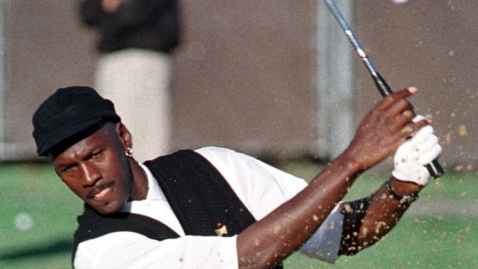 CHICAGO, IL - SEPTEMBER 15:  Former Chicago Bulls player Michael Jordan gets in a little prctice coming out of a trap prior to playing in  his first professional golf tournament 15 September 1999.  Jordan is playing in the LaSalle Banks Chicago Open held 15-17 September at the Beverly Country Club in Chicago.  (Photo credit should read RICHARD COREY/AFP via Getty Images)