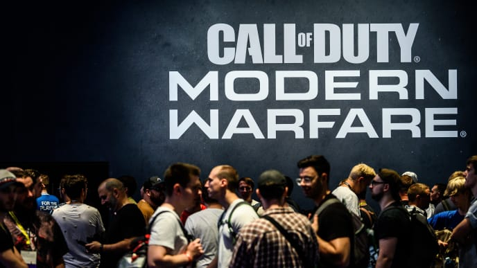 COLOGNE, GERMANY - AUGUST 20: Visitors wait to try out the latest version of Call of Duty Modern Warfare during the press day at the 2019 Gamescom gaming trade fair on August 20, 2019 in Cologne, Germany. Gamescom 2019, the biggest video gaming trade fair in the world, will be open to the public from August 21-24.  (Photo by Lukas Schulze/Getty Images)