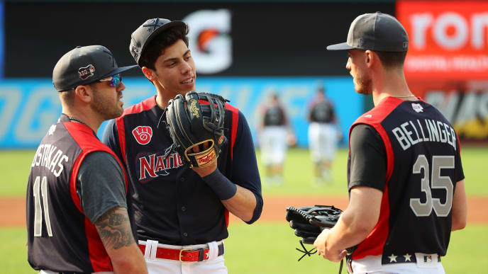 CLEVELAND, OHIO - JULY 08: Mike Moustakas and Christian Yelich of the Milwaukee Brewers speak with Cody Bellinger of the Los Angeles Dodgers during Gatorade All-Star Workout Day at Progressive Field on July 08, 2019 in Cleveland, Ohio. (Photo by Gregory Shamus/Getty Images)