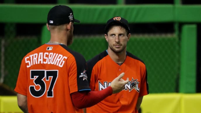 MIAMI, FL - JULY 10:  Stephen Strasburg #37 of the Washington Nationals and the National League talks to Max Scherzer #31 of the Washington Nationals and the National League during Gatorade All-Star Workout Day ahead of the 88th MLB All-Star Game at Marlins Park on July 10, 2017 in Miami, Florida.  (Photo by Rob Carr/Getty Images)
