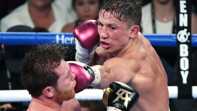 LAS VEGAS, NV - SEPTEMBER 15:  Gennady Golovkin (R) throws a left at Canelo Alvarez in the 12th round of their WBC/WBA middleweight title fight at T-Mobile Arena on September 15, 2018 in Las Vegas, Nevada. Alvarez won by majority decision.  (Photo by Ethan Miller/Getty Images)
