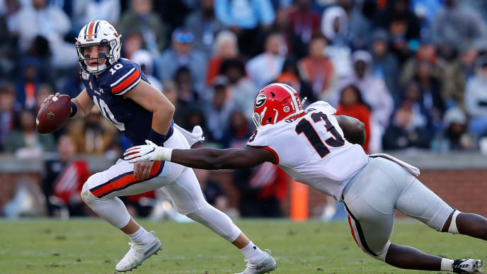 AUBURN, ALABAMA - NOVEMBER 16:  Bo Nix #10 of the Auburn Tigers is pressured out of the pocket by Azeez Ojulari #13 of the Georgia Bulldogs in the first half at Jordan-Hare Stadium on November 16, 2019 in Auburn, Alabama. (Photo by Kevin C. Cox/Getty Images)