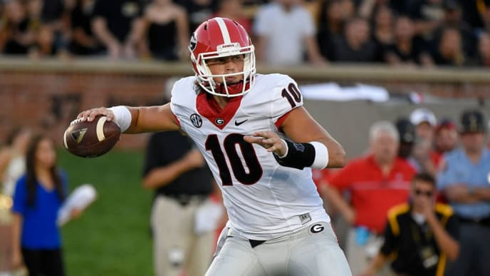 COLUMBIA, MO - SEPTEMBER 17:  Jacob Eason #10 of the Georgia Bulldogs drops back for a pass against the Missouri Tigers in the first quarter at Memorial Stadium on September 17, 2016 in Columbia, Missouri. (Photo by Ed Zurga/Getty Images)