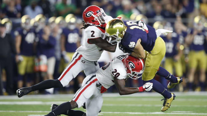 SOUTH BEND, IN - SEPTEMBER 09: Richard LeCounte III #2 and J.R. Reed #20 of the Georgia Bulldogs tackle Chris Finke #10 of the Notre Dame Fighting Irish in the fourth quarter of a game at Notre Dame Stadium on September 9, 2017 in South Bend, Indiana. Georgia won 20-19. (Photo by Joe Robbins/Getty Images)