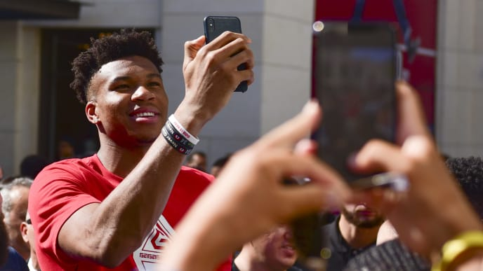LOS ANGELES, CALIFORNIA - JULY 13: NBA MVP Giannis Antetokounmpo takes selfie with fans at Nike at The Grove in Los Angeles at Nike Store at The Grove on July 13, 2019 in Los Angeles, California. (Photo by Rodin Eckenroth/Getty Images)