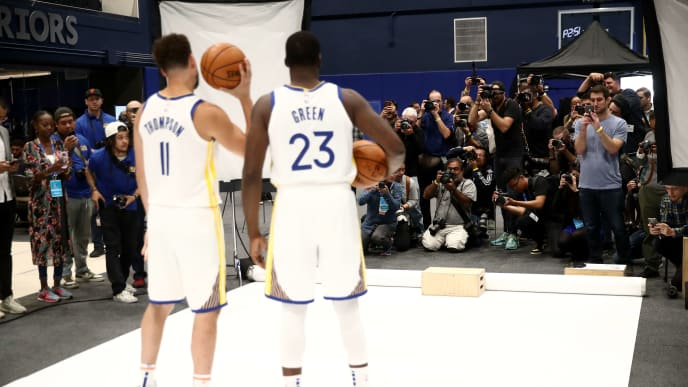 SAN FRANCISCO, CALIFORNIA - SEPTEMBER 30:  Draymond Green #23  and Klay Thompson #11 of the Golden State Warriors pose for a picture during the Golden State Warriors media day at Chase Center on September 30, 2019 in San Francisco, California. NOTE TO USER: User expressly acknowledges and agrees that, by downloading and or using this photograph, User is consenting to the terms and conditions of the Getty Images License Agreement.  (Photo by Ezra Shaw/Getty Images)