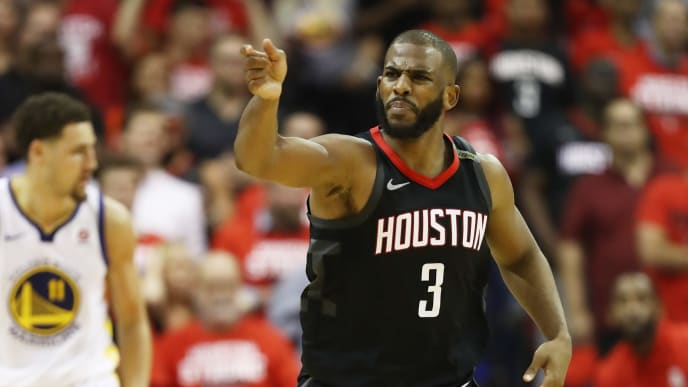 HOUSTON, TX - MAY 24:  Chris Paul #3 of the Houston Rockets reacts against the Golden State Warriors in the fourth quarter of Game Five of the Western Conference Finals of the 2018 NBA Playoffs at Toyota Center on May 24, 2018 in Houston, Texas. NOTE TO USER: User expressly acknowledges and agrees that, by downloading and or using this photograph, User is consenting to the terms and conditions of the Getty Images License Agreement. (Photo by Ronald Martinez/Getty Images)