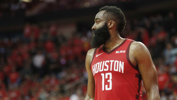 HOUSTON, TX - MAY 04:  James Harden #13 of the Houston Rockets reacts in overtime during Game Three of the Second Round of the 2019 NBA Western Conference Playoffs against the Golden State Warriors at Toyota Center on May 4, 2019 in Houston, Texas.  NOTE TO USER: User expressly acknowledges and agrees that, by downloading and or using this photograph, User is consenting to the terms and conditions of the Getty Images License Agreement.  (Photo by Tim Warner/Getty Images)