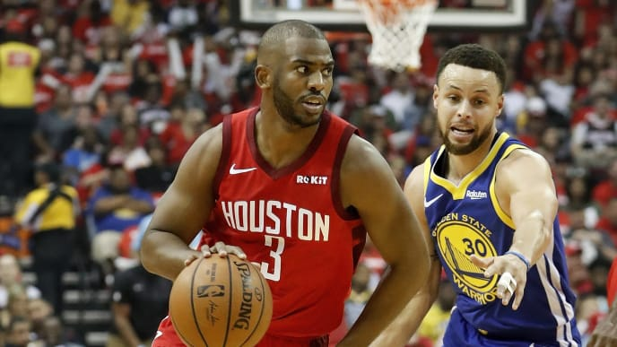 HOUSTON, TX - MAY 04:  Chris Paul #3 of the Houston Rockets drives to the basket defended by Stephen Curry #30 of the Golden State Warriors in the first half during Game Three of the Second Round of the 2019 NBA Western Conference Playoffs at Toyota Center on May 4, 2019 in Houston, Texas.  NOTE TO USER: User expressly acknowledges and agrees that, by downloading and or using this photograph, User is consenting to the terms and conditions of the Getty Images License Agreement.  (Photo by Tim Warner/Getty Images)