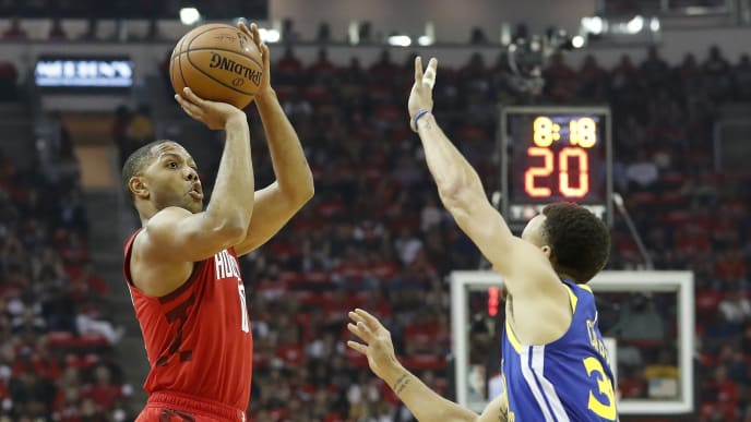 HOUSTON, TX - MAY 04:  Eric Gordon #10 of the Houston Rockets shoots the ball defended by Stephen Curry #30 of the Golden State Warriors in the first quarter during Game Three of the Second Round of the 2019 NBA Western Conference Playoffs at Toyota Center on May 4, 2019 in Houston, Texas.  NOTE TO USER: User expressly acknowledges and agrees that, by downloading and or using this photograph, User is consenting to the terms and conditions of the Getty Images License Agreement.  (Photo by Tim Warner/Getty Images)