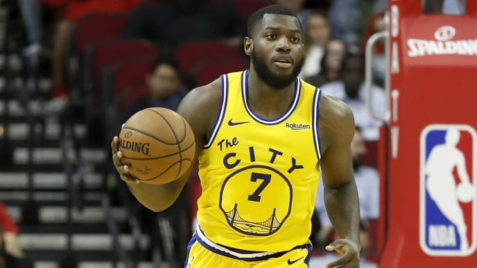 HOUSTON, TX - NOVEMBER 06:  Eric Paschall #7 of the Golden State Warriors brings the ball up court in the second half against the Houston Rockets at Toyota Center on November 6, 2019 in Houston, Texas.    NOTE TO USER: User expressly acknowledges and agrees that, by downloading and or using this photograph, User is consenting to the terms and conditions of the Getty Images License Agreement.  (Photo by Tim Warner/Getty Images)