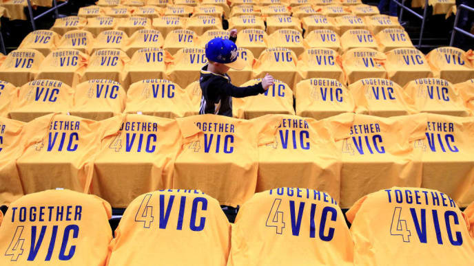 INDIANAPOLIS, INDIANA - JANUARY 28:   A fan walk thru rows of seats that are adorned with shirts showing support for injured Pacers player Victor Oladipo before the Golden State Warriors game against the Indiana Pacers at Bankers Life Fieldhouse on January 28, 2019 in Indianapolis, Indiana. (Photo by Andy Lyons/Getty Images)