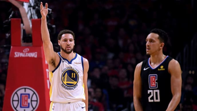 LOS ANGELES, CALIFORNIA - APRIL 18:  Klay Thompson #11 of the Golden State Warriors celebrates his blocked shot in front of Landry Shamet #20 of the LA Clippers during a 132-105 Warriors win during Game Two of Round One of the 2019 NBA Playoffs at Staples Center on April 18, 2019 in Los Angeles, California. (Photo by Harry How/Getty Images)  NOTE TO USER: User expressly acknowledges and agrees that, by downloading and or using this photograph, User is consenting to the terms and conditions of the Getty Images License Agreement.