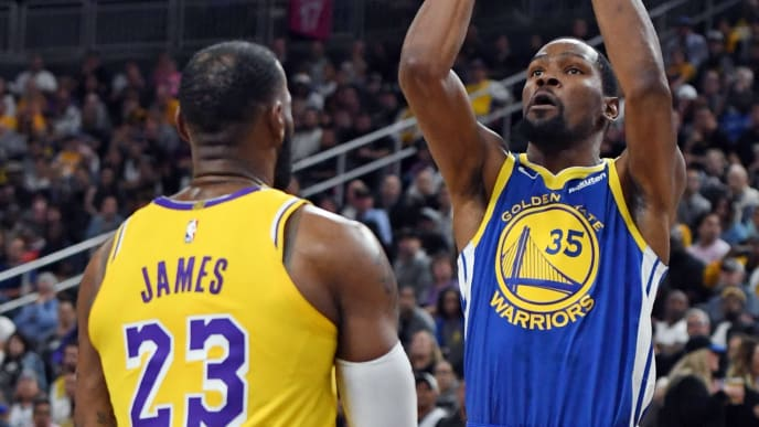 LAS VEGAS, NEVADA - OCTOBER 10:  Kevin Durant #35 of the Golden State Warriors shoots against LeBron James #23 of the Los Angeles Lakers during their preseason game at T-Mobile Arena on October 10, 2018 in Las Vegas, Nevada. The Lakers defeated the Warriors 123-113. NOTE TO USER: User expressly acknowledges and agrees that, by downloading and or using this photograph, User is consenting to the terms and conditions of the Getty Images License Agreement.  (Photo by Ethan Miller/Getty Images)