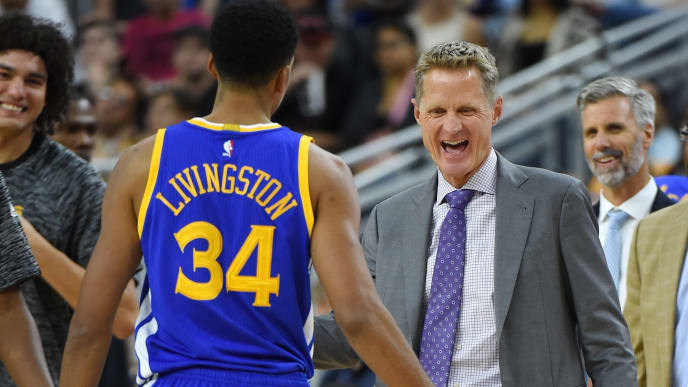 LAS VEGAS, NV - OCTOBER 15:  Head coach Steve Kerr of the Golden State Warriors smiles at Shaun Livingston #34 as he walks off the court during a timeout in their preseason game against the Los Angeles Lakers at T-Mobile Arena on October 15, 2016 in Las Vegas, Nevada. Golden State won 112-107. NOTE TO USER: User expressly acknowledges and agrees that, by downloading and or using this photograph, User is consenting to the terms and conditions of the Getty Images License Agreement.  (Photo by Ethan Miller/Getty Images)