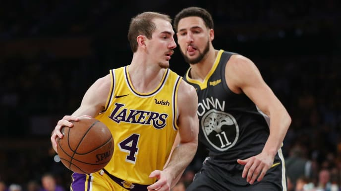 LOS ANGELES, CALIFORNIA - APRIL 04: Alex Caruso #4 of the Los Angeles Lakers drives against Klay Thompson #11 of the Golden State Warriors during the second half at Staples Center on April 04, 2019 in Los Angeles, California. NOTE TO USER: User expressly acknowledges and agrees that, by downloading and or using this photograph, User is consenting to the terms and conditions of the Getty Images License Agreement. (Photo by Yong Teck Lim/Getty Images)