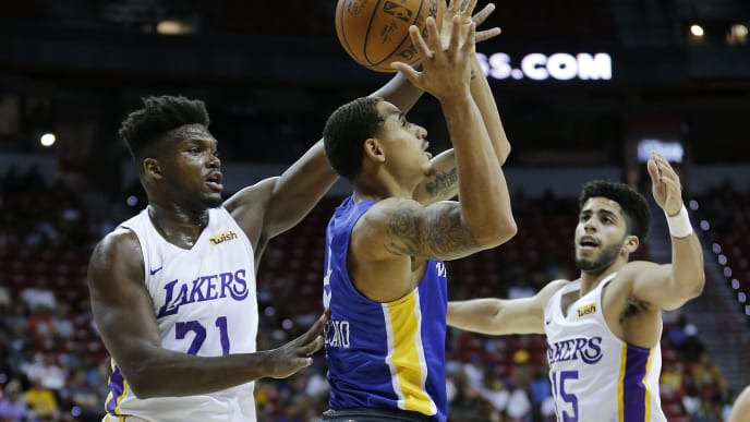 LAS VEGAS, NEVADA - JULY 08:  Juan Toscano-Anderson #8 of the Golden State Warriors grabs a rebound from Nick Perkins #21 and Jordan Howard #15 of the Los Angeles Lakers during the 2019 NBA Summer League at the Thomas & Mack Center on July 08, 2019 in Las Vegas, Nevada. NOTE TO USER: User expressly acknowledges and agrees that, by downloading and or using this photograph, User is consenting to the terms and conditions of the Getty Images License Agreement.  (Photo by Michael Reaves/Getty Images)