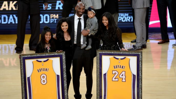 LOS ANGELES, CA - DECEMBER 18:  Kobe Bryant poses with his family at halftime after both his #8 and #24 Los Angeles Lakers jerseys are retired at Staples Center on December 18, 2017 in Los Angeles, California. NOTE TO USER: User expressly acknowledges and agrees that, by downloading and or using this photograph, User is consenting to the terms and conditions of the Getty Images License Agreement.  (Photo by Maxx Wolfson/Getty Images)
