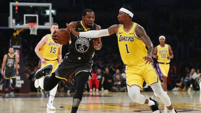 LOS ANGELES, CALIFORNIA - APRIL 04: Kevin Durant #35 of the Golden State Warriors drives against Kentavious Caldwell-Pope #1 of the Los Angeles Lakers during the first half at Staples Center on April 04, 2019 in Los Angeles, California. NOTE TO USER: User expressly acknowledges and agrees that, by downloading and or using this photograph, User is consenting to the terms and conditions of the Getty Images License Agreement. (Photo by Yong Teck Lim/Getty Images)