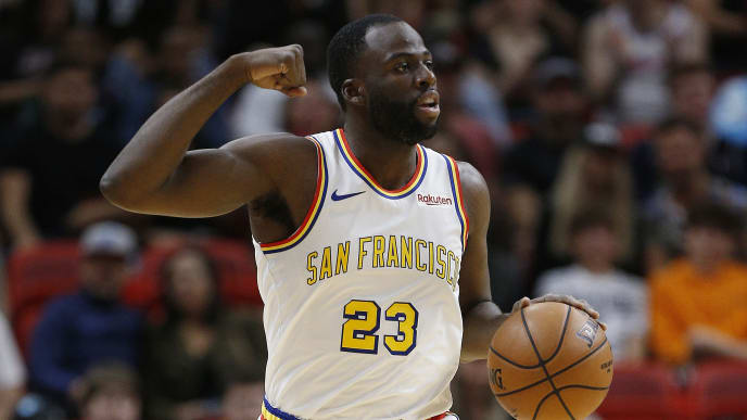 MIAMI, FLORIDA - NOVEMBER 29:  Draymond Green #23 of the Golden State Warriors dribbles the ball up the court against the Miami Heat during the first half at American Airlines Arena on November 29, 2019 in Miami, Florida. NOTE TO USER: User expressly acknowledges and agrees that, by downloading and/or using this photograph, user is consenting to the terms and conditions of the Getty Images License Agreement. (Photo by Michael Reaves/Getty Images)