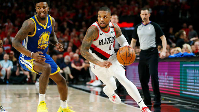 PORTLAND, OREGON - MAY 20: Damian Lillard #0 of the Portland Trail Blazers dribbles during the second half against the Golden State Warriors in game four of the NBA Western Conference Finals at Moda Center on May 20, 2019 in Portland, Oregon. NOTE TO USER: User expressly acknowledges and agrees that, by downloading and or using this photograph, User is consenting to the terms and conditions of the Getty Images License Agreement. (Photo by Jonathan Ferrey/Getty Images)