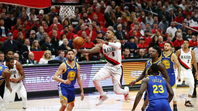 PORTLAND, OREGON - MAY 20: Damian Lillard #0 of the Portland Trail Blazers drives to the basket during the first half against the Golden State Warriors in game four of the NBA Western Conference Finals at Moda Center on May 20, 2019 in Portland, Oregon. NOTE TO USER: User expressly acknowledges and agrees that, by downloading and or using this photograph, User is consenting to the terms and conditions of the Getty Images License Agreement. (Photo by Jonathan Ferrey/Getty Images)