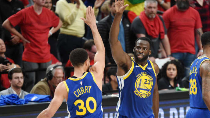 PORTLAND, OREGON - MAY 20: Stephen Curry #30 of the Golden State Warriors high fives Draymond Green #23 during the second half against the Portland Trail Blazers in game four of the NBA Western Conference Finals at Moda Center on May 20, 2019 in Portland, Oregon. NOTE TO USER: User expressly acknowledges and agrees that, by downloading and or using this photograph, User is consenting to the terms and conditions of the Getty Images License Agreement. (Photo by Steve Dykes/Getty Images)