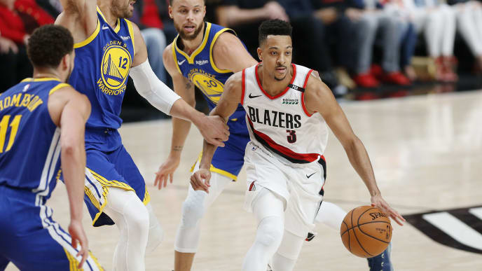 PORTLAND, OREGON - MAY 20: CJ McCollum #3 of the Portland Trail Blazers handles the ball during the second half against the Golden State Warriors in game four of the NBA Western Conference Finals at Moda Center on May 20, 2019 in Portland, Oregon. NOTE TO USER: User expressly acknowledges and agrees that, by downloading and or using this photograph, User is consenting to the terms and conditions of the Getty Images License Agreement. (Photo by Jonathan Ferrey/Getty Images)
