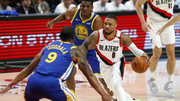 PORTLAND, OREGON - MAY 18: Damian Lillard #0 of the Portland Trail Blazers dribbles during the first half against the Golden State Warriors in game three of the NBA Western Conference Finals at Moda Center on May 18, 2019 in Portland, Oregon. NOTE TO USER: User expressly acknowledges and agrees that, by downloading and or using this photograph, User is consenting to the terms and conditions of the Getty Images License Agreement. (Photo by Jonathan Ferrey/Getty Images)