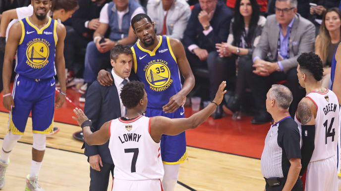 TORONTO,ONTARIO - JUNE 10:  Kyle Lowry #7 of the Toronto Raptors tries to get the crowd to appreciate an injured Kevin Durant #35 of the Golden State Warriors during Game Five of the 2019 NBA Finals at Scotiabank Arena on June 10, 2019 in Toronto, Canada. NOTE TO USER: User expressly acknowledges and agrees that, by downloading and or using this photograph, User is consenting to the terms and conditions of the Getty Images License Agreement. (Photo by Claus Andersen/Getty Images)