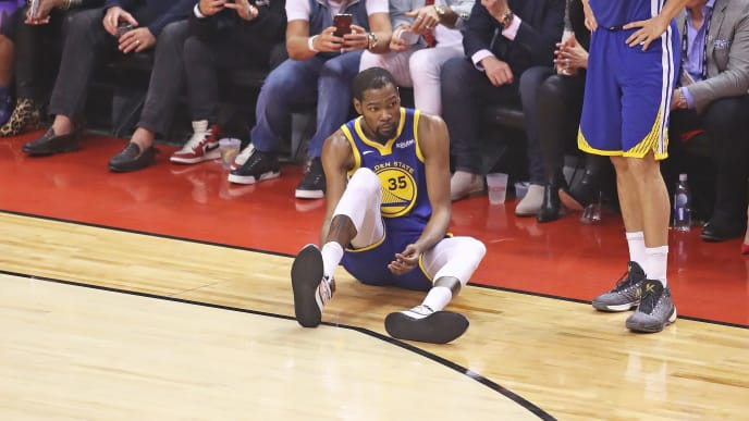 TORONTO,ONTARIO - JUNE 10:  Kevin Durant #35 of the Golden State Warriors goes down with an apparent achilles injury during action against the Toronto Raptors in Game Five of the 2019 NBA Finals at Scotiabank Arena on June 10, 2019 in Toronto, Canada. NOTE TO USER: User expressly acknowledges and agrees that, by downloading and or using this photograph, User is consenting to the terms and conditions of the Getty Images License Agreement. (Photo by Claus Andersen/Getty Images)